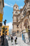 Malaga - domkyrkatorn och fasad och Plaza del Obispo Royaltyfri Foto