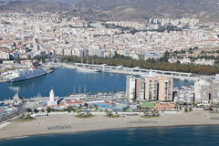 Malaga harbor with its downtown at the back seen from air. Royalty Free Stock Photo