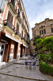 MALAGA - JUNE 12: City street view with cafeteria terraces and s Stock Photos