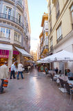 MALAGA - JUNE 12: City street view with cafeteria terraces and s Royalty Free Stock Photos