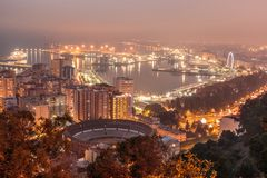 Malaga at night with harbor and ships and lighting area royalty free stock images