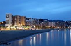 Malaga på natten, Spanien Arkivfoto