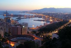 Malaga Port and bullring at dusk. Stock Photos