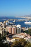 Malaga port and bullring. Royalty Free Stock Image