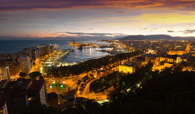 Malaga with Port from castle in evening Royalty Free Stock Image