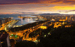Malaga with Port from castle in evening Royalty Free Stock Photography