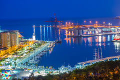 Malaga port at night in Spain Stock Photo