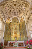 Malaga - The presbytery and main altar with the statue of st. Jacob the Apostle in church Iglesia del Santiago Apostol Stock Image