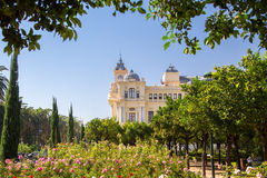 Malaga, Spain. A park in the city of Malaga with a beautiful building in the centre Stock Photography