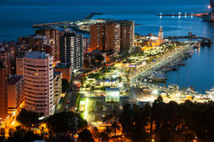 Malaga, Spain. Aerial view of apartment buildings and hotels. In Malaga, Andalusia, Spain with sea and port, moored yachts at night Stock Photos