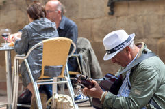 MALAGA, SPAIN - APRIL 29: Two men playing spanish guitar and sin Stock Photo