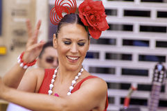 MALAGA, SPAIN - AUGUST, 14: Dancers in flamenco style dress at t. He Malaga August Fair on August, 14, 2009 in Malaga, Spain royalty free stock photo