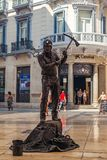 Human statue of a miner. Malaga, Spain - August 03, 2018. Human statue of a miner performs on the Marques de Larios pedestrian, in the historic center of Malaga stock photos