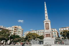 MALAGA, SPAIN - DECEMBER 5th, 2017: Merced Square and monolith in the centre, and people walking around it, on December 5th, 2017 stock image