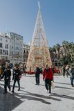 MALAGA, SPAIN - DECEMBER 5th, 2017: View of Malaga city center life at christmas , with people walking in the street. Royalty Free Stock Image