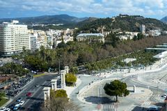Beautiful view of the historical part of the city of Malaga with a review wheel. Castle, streets, harbor, cars stock image