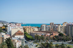 MALAGA, SPAIN - FEBRUARY 16, 2014: An iconic panoramic view from a castle of Malaga to the city and Mediterranean sea. Andalusia, Spain Royalty Free Stock Image