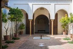 MALAGA, SPAIN - FEBRUARY 16, 2014: A quiet yard at Alcazaba, a castle of Malaga. With orange trees at pots, fountains and arch entrance in arab style Stock Images