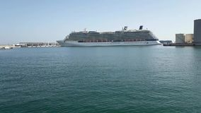 Celebrity Reflection Cruise Ship leaving the docks from Malaga port stock footage