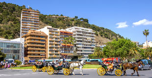 MALAGA, SPAIN - JUNE, 14: Horsemen and carriages in the city str Royalty Free Stock Image