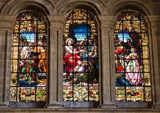 Religious scene the Anointing of Jesus on stained glass window stock images