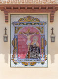 MALAGA, SPAIN - MAY 25, 2015: The ceramic tiled, cried Madonna under the Crucifixion on the facade of church Parroquia de San Pedr Royalty Free Stock Photo