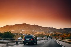 Malaga, Spain. Movement of vehicles on freeway, motorway A-7 In Sunset. Time royalty free stock photo