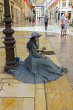 Malaga, Spain September 2, 2014: Young disguised entertains pass Stock Photo