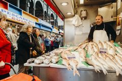 Malaga, Spain: 5th December, 2017: Fishmonger selling fresh fish in his shop at Atarazanas Market, in Malaga city center, Spain, o stock images