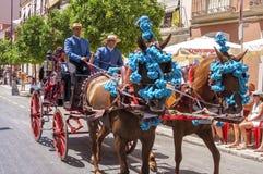 MALAGA SPANIEN - AUGUSTI, 14: Skickliga ryttare och vagnar på Malagaen Arkivfoton
