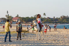 Malagasy beauty, beautiful girls ride horse on the beach Royalty Free Stock Photography