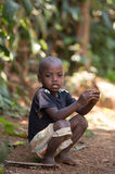 Malagasy boy in torn clothes Royalty Free Stock Photos