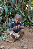 Malagasy boy in torn clothes Royalty Free Stock Images