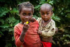 Malagasy childcare. Young girl taking care of her younger brother, Madagascar Royalty Free Stock Photos