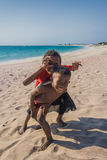 Malagasy children on the beach Royalty Free Stock Image
