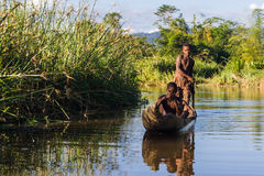 Malagasy children paddling Stock Photo