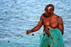 Malagasy fisherman pulling nets Royalty Free Stock Photo
