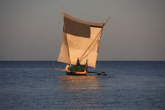 Malagasy fishermen and their outrigger canoes Stock Photos