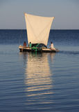 Malagasy fishermen and their outrigger canoes Royalty Free Stock Images