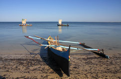 Malagasy fishermen and their outrigger canoes Royalty Free Stock Image