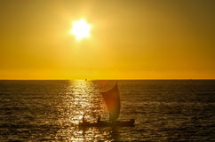 Malagasy fishing pirogue at sunset Stock Photography