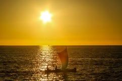 Malagasy fishing pirogue at sunset Stock Photography