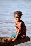 Malagasy girl in a boat Stock Images