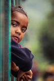 Malagasy girl looking from a train window Stock Photos