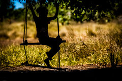 Malagasy girl on a swing Stock Image