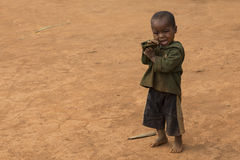 Malagasy kid isolated on a dusty background Stock Photo