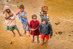Malagasy kids in the mud. Group of little kids standing in the mud and posing for a picture, Madagascar Stock Photo