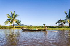 Malagasy man paddling Royalty Free Stock Photos
