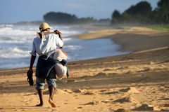 Malagasy man walking on a beach Royalty Free Stock Photo