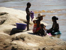 Malagasy natives near river Stock Photo